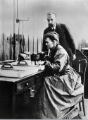 Pierre and Marie Curie at work in their ...